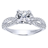 This diamond encrusted split shank criss cross style diamond engagement ring with one third carats of round brilliant diamonds sets up a center cut princess diamonds.