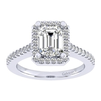 This subtle and clean emerald cut diamond halo engagement ring with over on third carats of round diamonds shimmers and glistens in white gold or platinum.