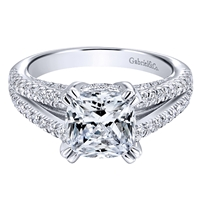 This fabulous cushion cut split shank diamond engagement ring is chock full of round brilliant diamonds with 2/3 carats of shimmering radiance!