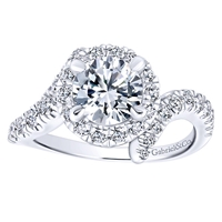 Three quarters of a carat of round brilliant diamonds swim around a gorgeous center diamond of your choice in this sexy and unique diamond engagement ring,