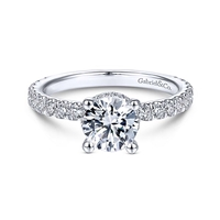 This diamond basket halo engagement ring features over one half carats of diamond shine.