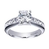 In white gold or platinum, this contemporary halo engagement ring explodes with 3/4 carats of round brilliant diamonds,