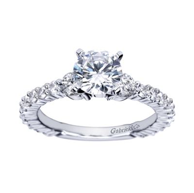 An 18k white gold eternity engagement ring with contemporary and modern styling, shining with nearly 1 full carat in round brilliant diamonds.