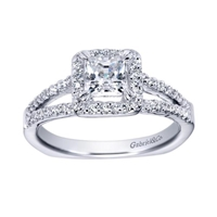 Gorgeous twin rows of white gold and diamonds make their way towards a princess cut diamond halo in this 14k white gold split shank princess halo engagement ring.