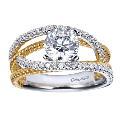 This two tone free form engagement ring features one quarter carats of round brilliant diamonds and is available in 14k or 18k gold.