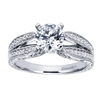 Double bands in white gold or platinum join at the center to cradle a round center diamond of your choice in this vintage style split shank engagement ring, featuring round brilliant diamonds.