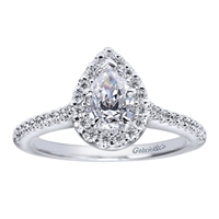 Round brilliant diamonds climb their way to the peak of this pear shape center diamond contemporary halo engagement ring in white gold or platinum.
