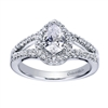 A center pear diamond sits perfectly in this split shank white gold or platinum contemporary halo engagement ring with round brilliant diamonds.