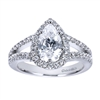 Platinum bands come together to form a pear shaped halo in this platinum split shank pear diamond halo engagement ring.