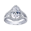 Double rows of round brilliant diamonds greet  pear shaped diamond halo in this platinum engagement ring.