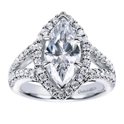 If you're looking for a marquise center diamond, you won't find a better halo engagement ring to surround it with this contemporary marquise halo engagement ring in white gold or platinum.