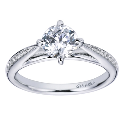An 18k white gold contemporary straight engagement ring with a twist, featuring round brilliant diamonds and a six prong setting in this engagement ring,