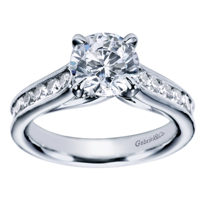 A substantial, well made and well designed contemporary straight engagement ring with one half carat in round brilliant diamonds, available in white gold or platinum.