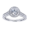 Featured in white gold and available in platinum, this wittily crafted vintage style halo engagement ring contains over one half carat in round brilliant diamonds.