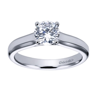 Sometimes a round center diamond just needs to be left alone! With this contemporary solitaire engagement ring will let that round center diamond shine.