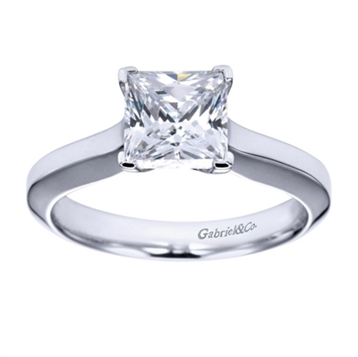 What more could anyone ask for than a beautifully cut princess diamond with a polished band in white gold or platinum in this contemporary solitaire engagement ring.