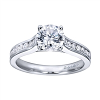 Round brilliant diamonds nestle into a contemporary straight engagement ring in your choice of white gold and platinum.