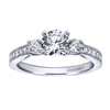 A classic 3 stone approach with a taste of the dramatic in its milgrain edging, this white gold or platinum vintage 3 stone engagement ring will light her eyes up with 12 carat of round brilliant diamonds.