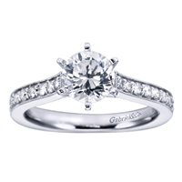 Round brilliant diamonds slide all the way up to this vintage style straight engagement ring's center, which should hold a round center diamond of your choice.