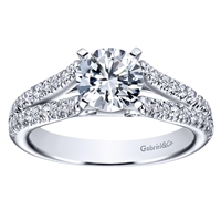 Double diamond rows of round brilliant diamonds crawl their way up this split shank diamond engagement ring, meeting a round center diamond of oyur choice.