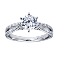 Intricately set round brilliant diamonds shimmer and glisten, setting up a round center diamond in the midst of one quarter carats of diamonds in this platinum split shank diamond engagement ring.