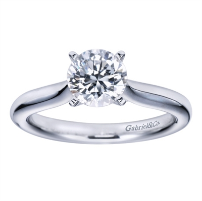 Simplicity at its finest, this smooth band thoughtfully cradles a round center diamond in a sturdy 4 prong setting in this solitaire engagement ring.