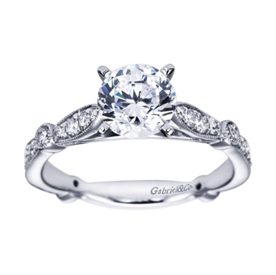 A meticulously crafted and carefully designed artistic vintage style engagement ring with round brilliant diamonds fitting a round center diamond