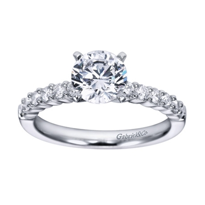 A white gold or platinum setting with round brilliant diamonds is featured in this contemporary straight engagement ring.