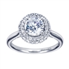 A smooth band in white gold or platinum meets a double halo of round diamonds in this contemporary halo engagement ring.