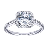 This striking and unique 14k white gold diamond halo engagement ring comes with nearly one half carat of scintillating round brilliant diamonds, with a simple setting to keep your eyes on the round center diamond of your choice!