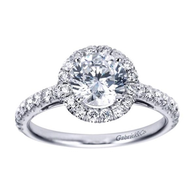 Gorgeous and stunning, this round diamond halo engagement ring cradles a round center diamond in its shimmering diamond halo with over one half carats in diamonds.  Enjoy the artful metalwork along the sides of this round diamond halo engagement ring.