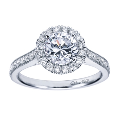 A milgrain finish with round brilliant diamonds make this contemporary halo engagement ring a refreshing and uplifting choice.