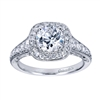 A stunning and well-decorated vintage style halo engagement ring with over half a carat in round brilliant diamonds.