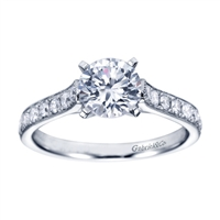 White gold and round diamonds mix spectacularly to form this vintage straight engagement ring available in white gold or platinum, featuring over 1/3 carat in diamonds.