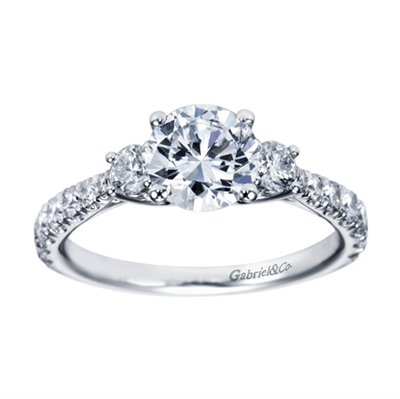 Blending round brilliant diamonds with your choice of white gold or platinum, this 3 stone contemporary engagement ring is an excellent pick.