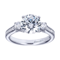 A 3 stone engagement ring with some style, this engagement ring is available in white gold or platinum and comes set with 0.50 carats in round diamonds.