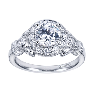 Feast your eyes on this immaculate white gold vintage halo engagement ring bustling with 0.65 carats of round brilliant diamonds, also available in platinum.