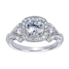 A well crafted and intricately designed vintage inspired halo engagement ring with round brilliant diamonds fitting a round center diamond of your choice.