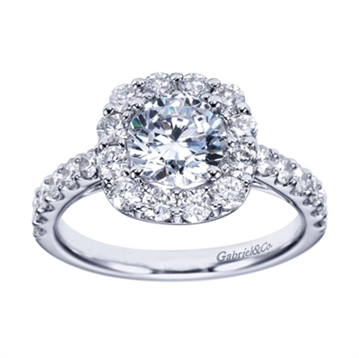 A glistening contemporary round diamond halo engagement ring available in your choice of white gold or platinum.