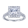 Round diamonds join a square engagement ring setting in white gold or platinum in this contemporary princess halo engagement ring.