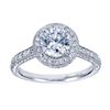 Your choice of platinum or white gold in this vintage style halo engagement ring with 3/4 carats of round brilliant diamonds and a round center diamond of your choice.