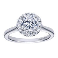 This stylish and unique solitaire style halo engagement ring boasts top qulaoty round brilliant diamonds all surrounding a shimmering round center diamond fo your choice.