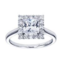 A stylish white gold or platinum band meets a round brilliant diamond halo holding a princess cut center diamond in this contemporary halo engagement ring.
