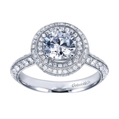 This white gold engagement ring has double rows of round diamonds to accent a round center diamond in this contemporary halo engagement ring.