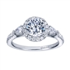 A uniquely designed contemporary halo engagement ring with round and pear diamonds surrounding an immaculate center diamond of your choice, engagement ring designed by Gabriel & Co.