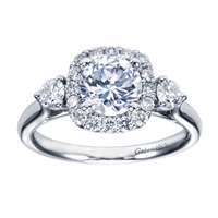 A Gabriel & Co. designer engagement ring that is very unique, this white gold 3 stone style halo engagement ring is sparkling with a half carat of round brilliant diamonds, including two larger side diamonds that really steal the show.