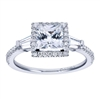 Round brilliant diamonds form a glistening halo while side baguette diamonds are a great accompaniment to a center princess cut diamond in this diamond-laden 14k white gold princess halo engagement ring.