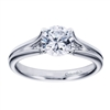 A white gold solitaire engagement ring with a contemporary twist! Designed by Gabriel & Co.