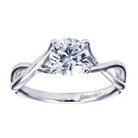 A swirling design engages your eyes upwards towards a round center stone in this subtle and well crafted contemporary solitaire engagement ring.