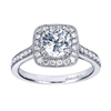 A Round center diamond floats spectacularly in the midst of 1/2 carat of round brilliant diamonds in this vintage inspired halo engagement ring.
